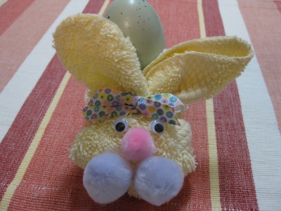 Decorating for Easter gifts, stand - a hare for the eggs.